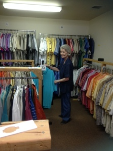 Clothes Closet volunteer working in the shirt room
