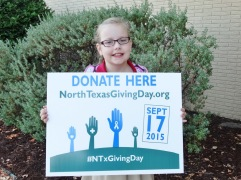 FLSNTXGivingDay2015 student with sign