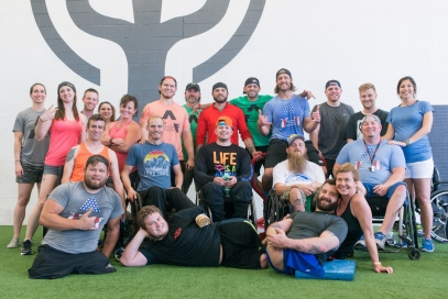 DALLAS, TX - JUNE17: Members of the Adaptive Training Foundation, led by Dave Vobora, a former NFL player, pose for a photograph following their workout at the Oakfit Gym in Dallas, TX, on Friday, June 17, 2016. Generally two thirds of the members of ATF are disabled war veterans. On top of the physical benefit, the participants expressed their appreciation for the sense of community and support that working in the gym offers and the confidence that comes with it.